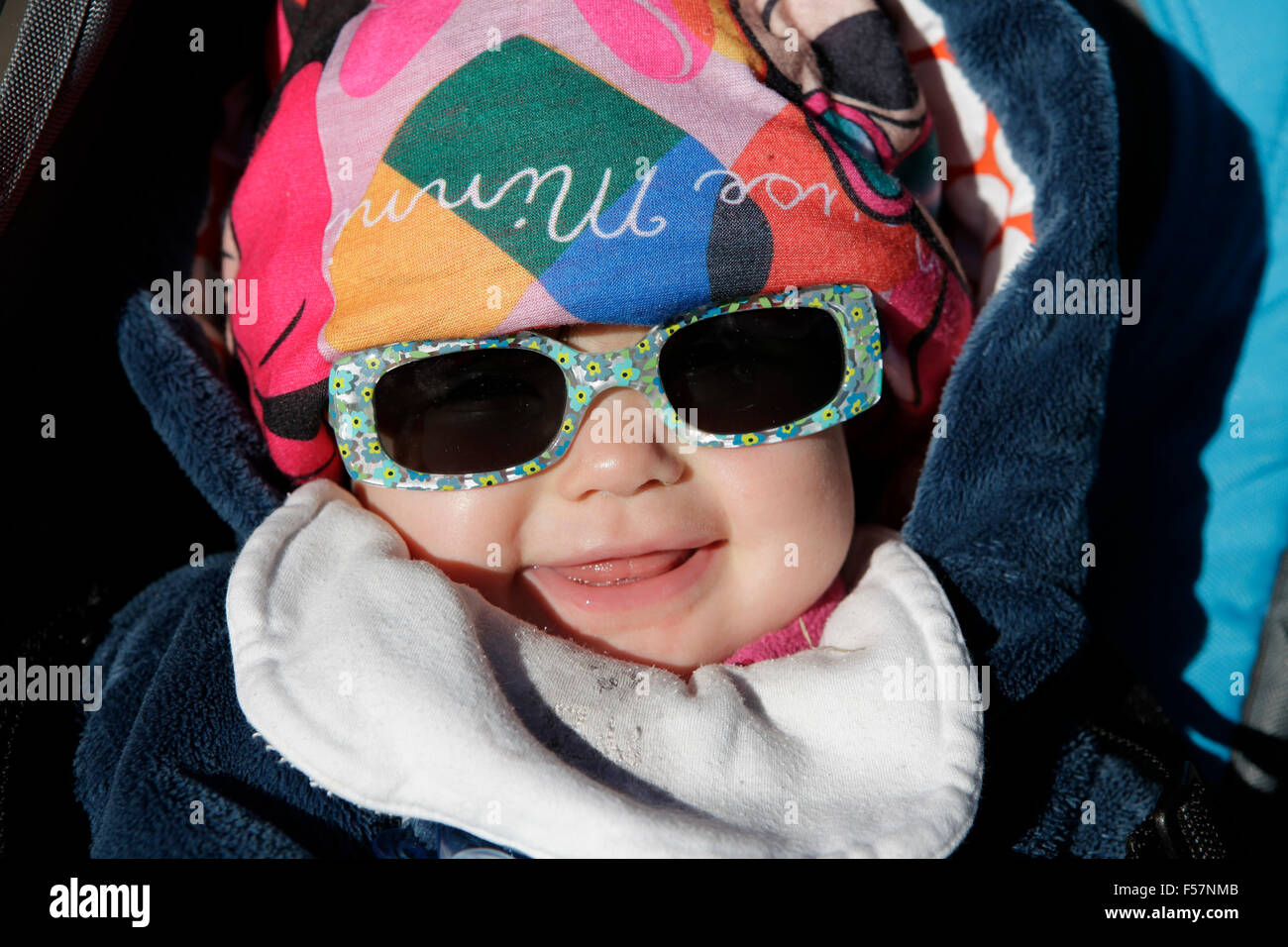 Little baby with sunglasses and caps. - Stock Image