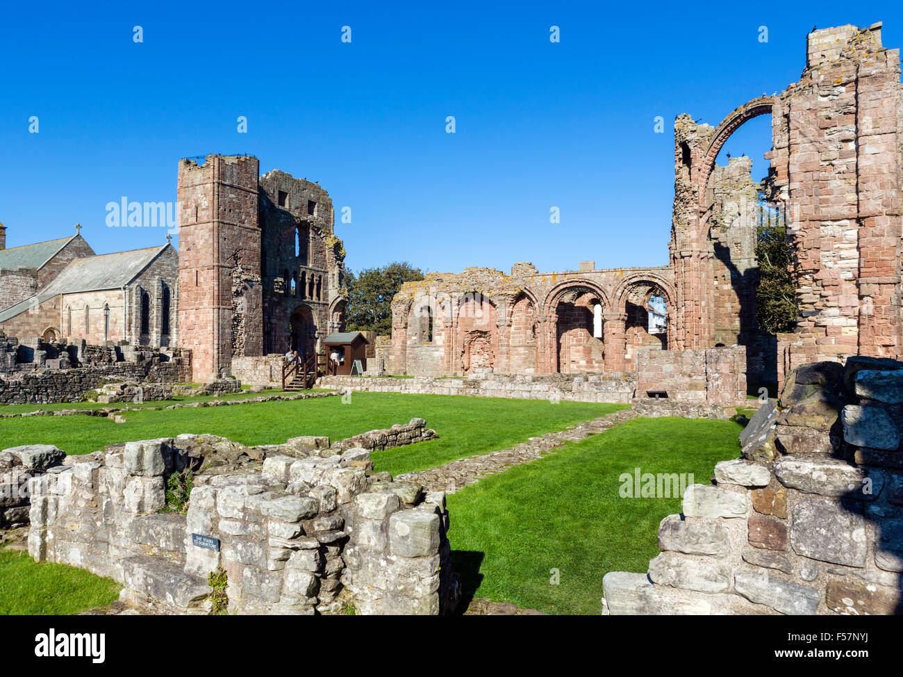 The ruins of the medieval Lindisfarne Priory, Holy Island, Northumberland, England, UK - Stock Image