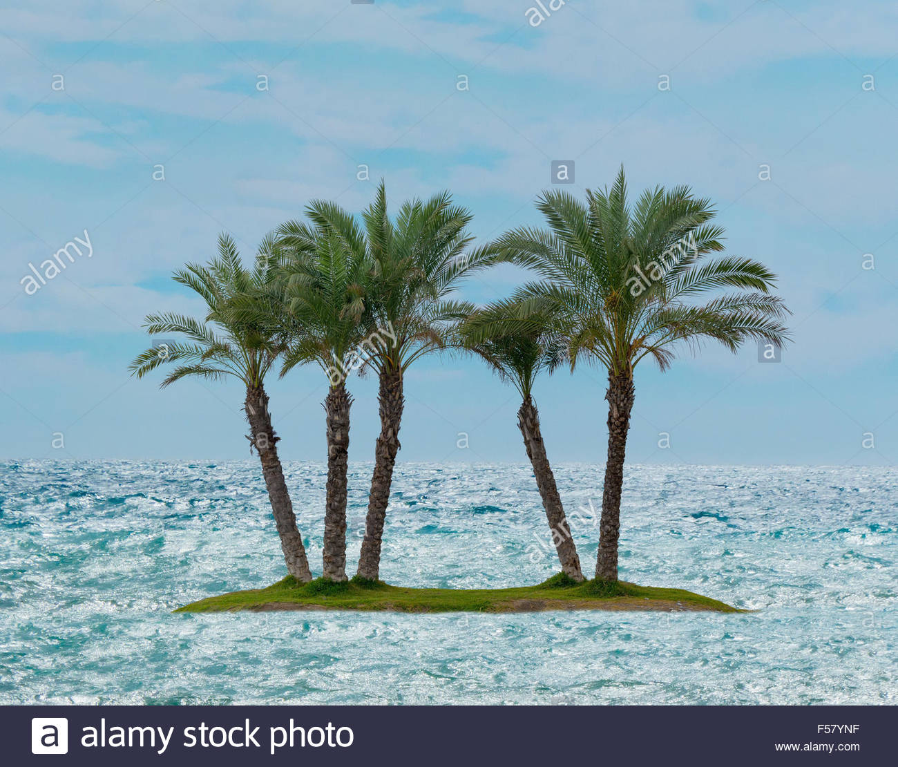 Desert island in the middle of the ocean - Stock Image