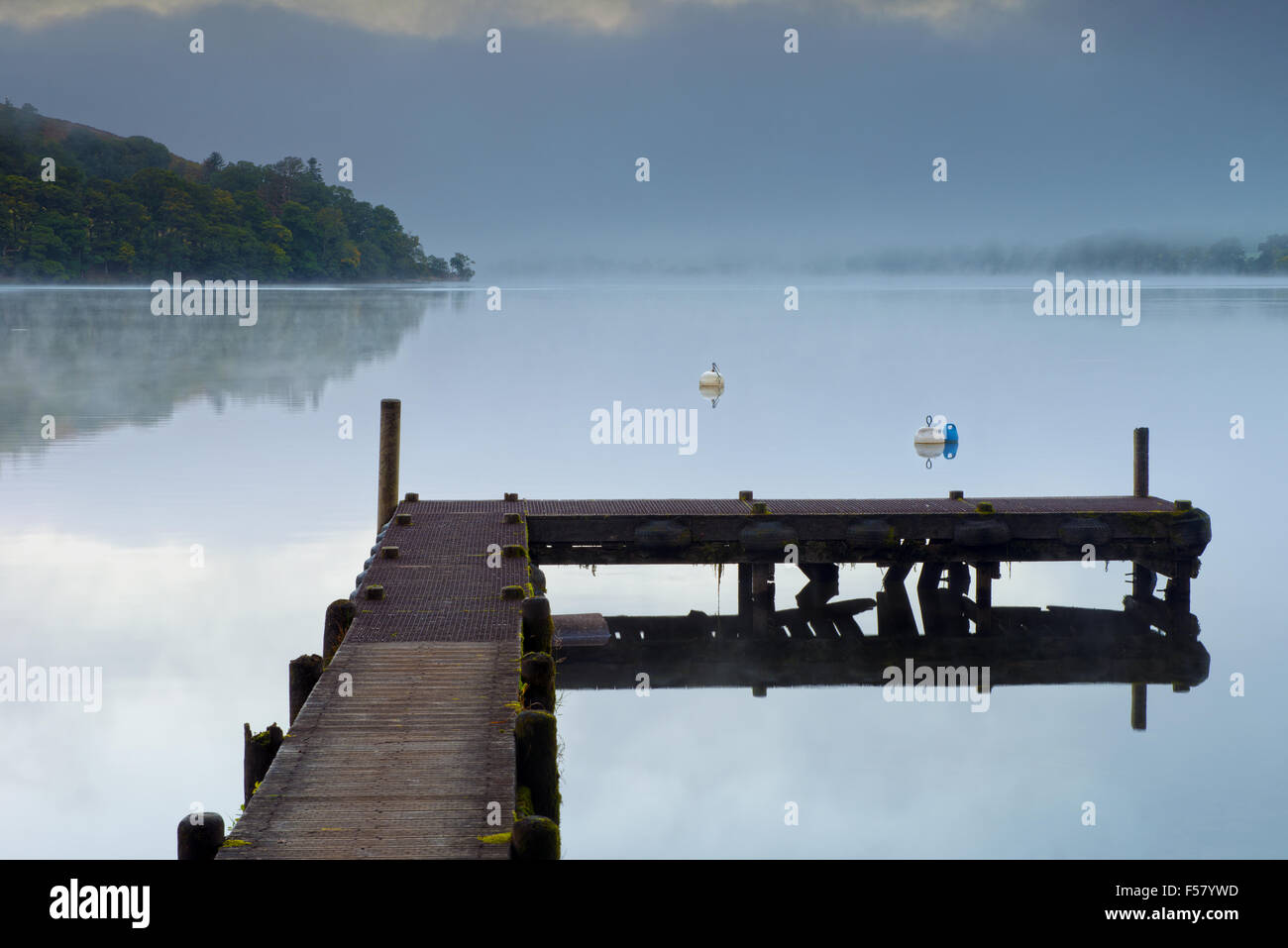 A Jetty stands on Ullswater Lake at Howtown at sunrise in the Lake District National Park, Cumbria, England, Uk, - Stock Image