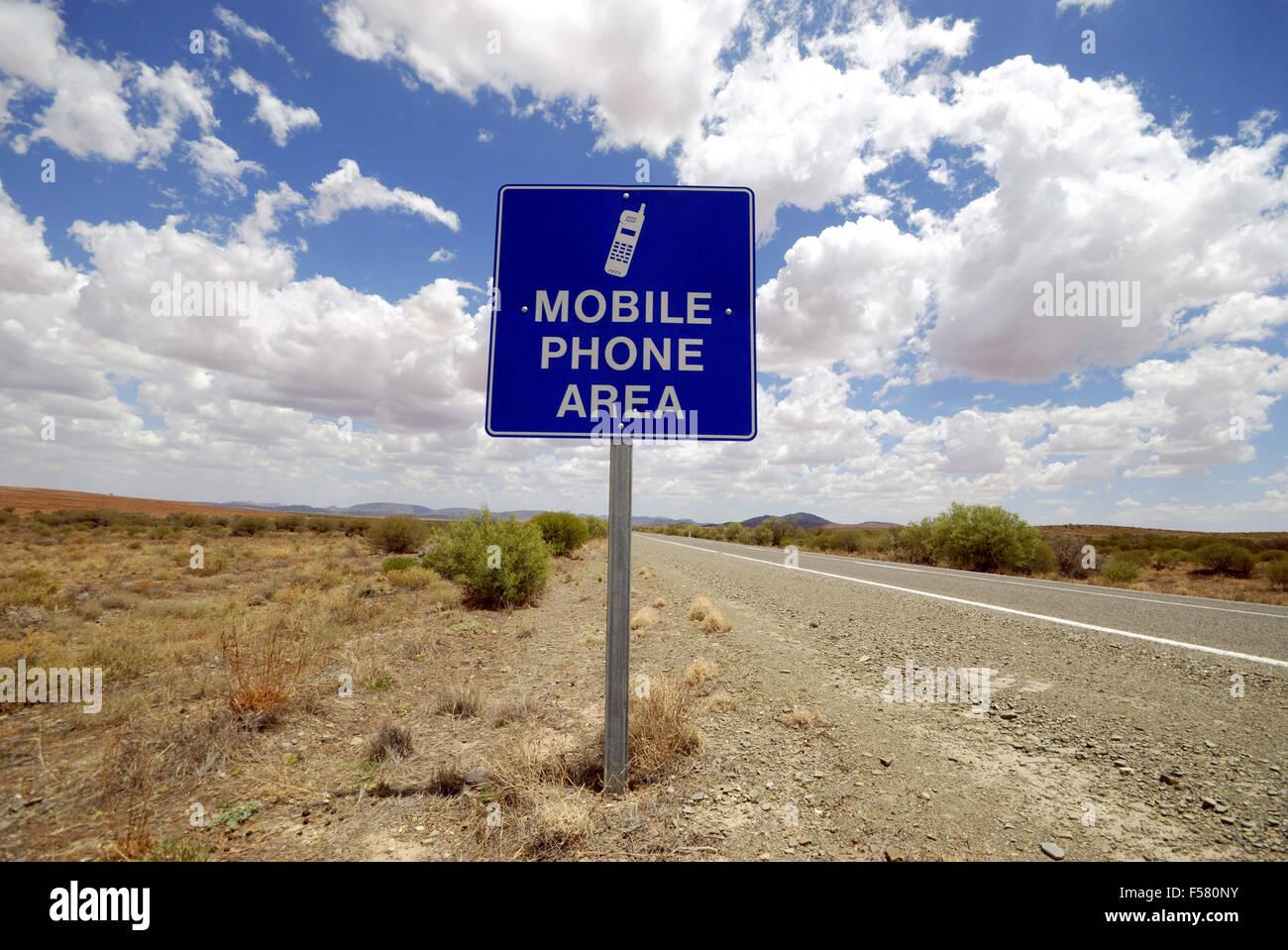 Mobile phone sign in the Australian desert - Stock Image
