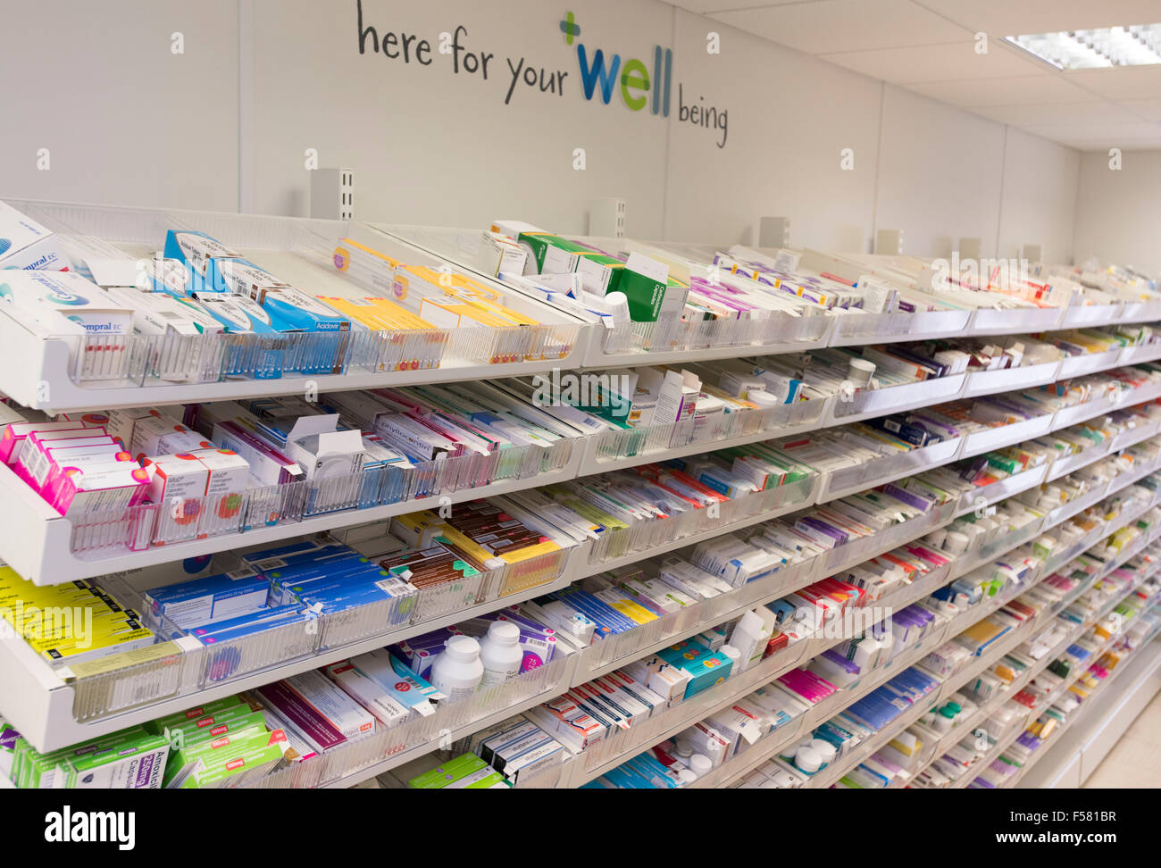 Drugs and medicines on pharmacy shelves in a chemist store. - Stock Image
