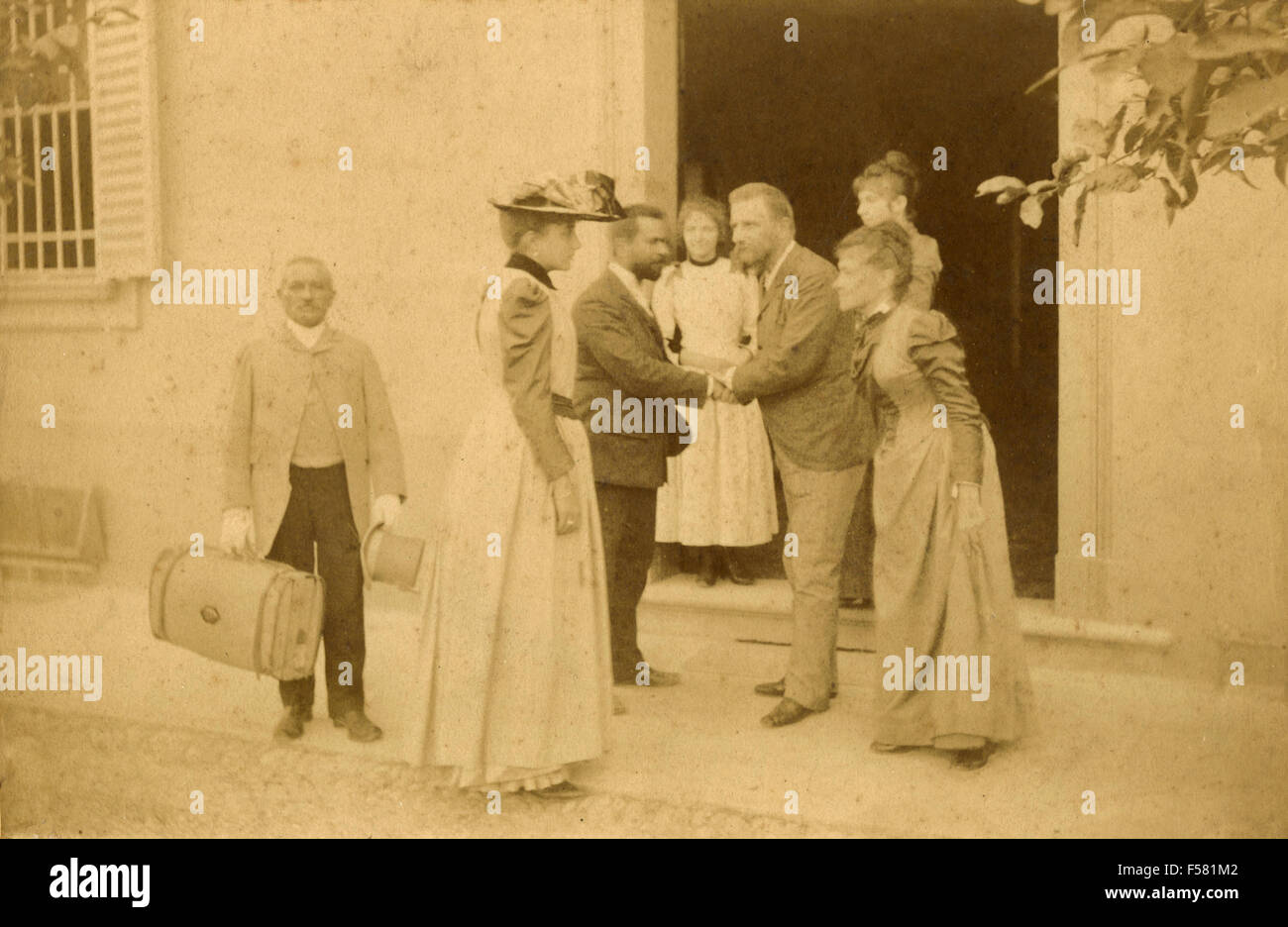 Greeting friends departing - Stock Image