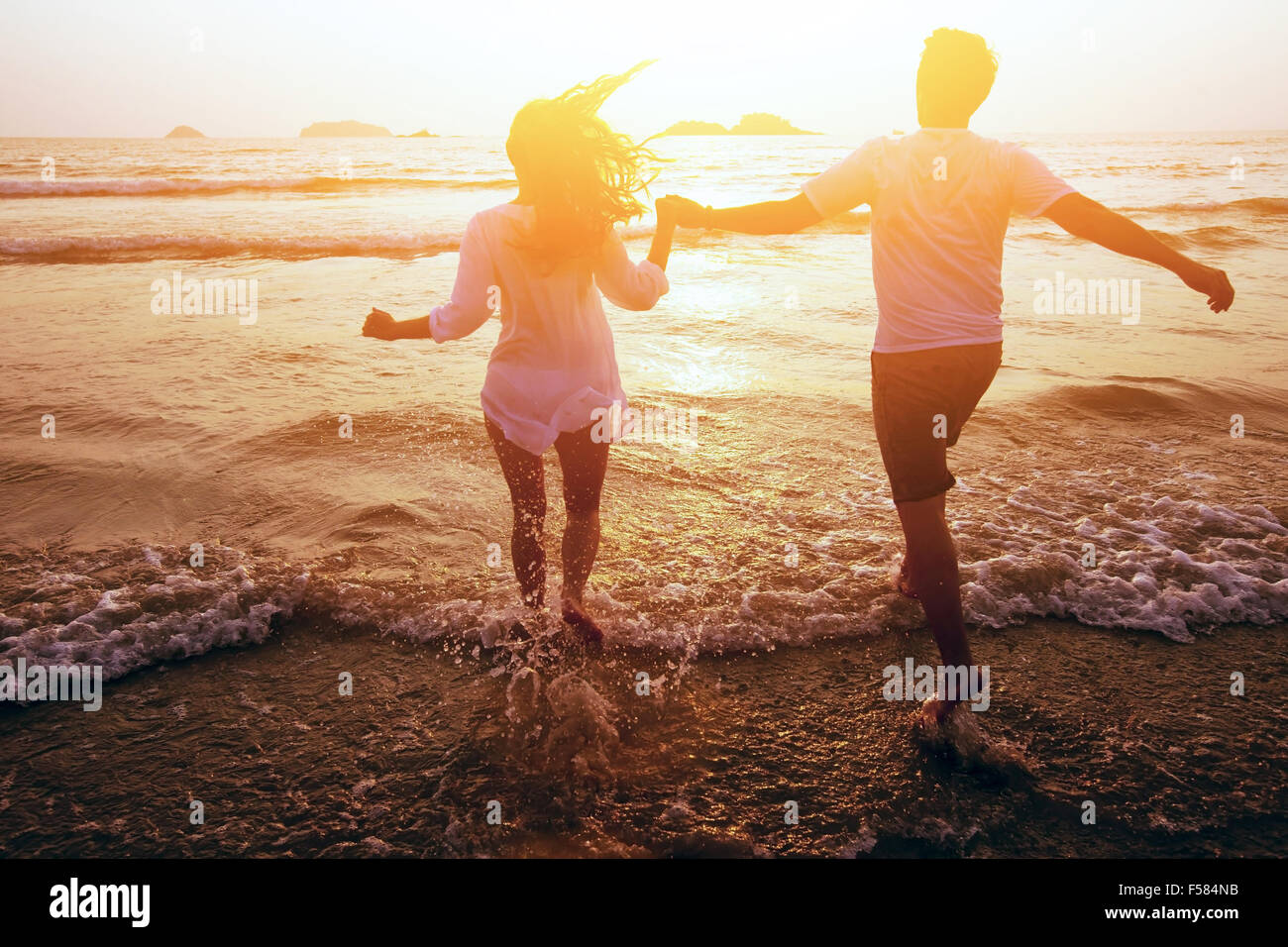 happy couple on the beach, summer vacations or honeymoon - Stock Image