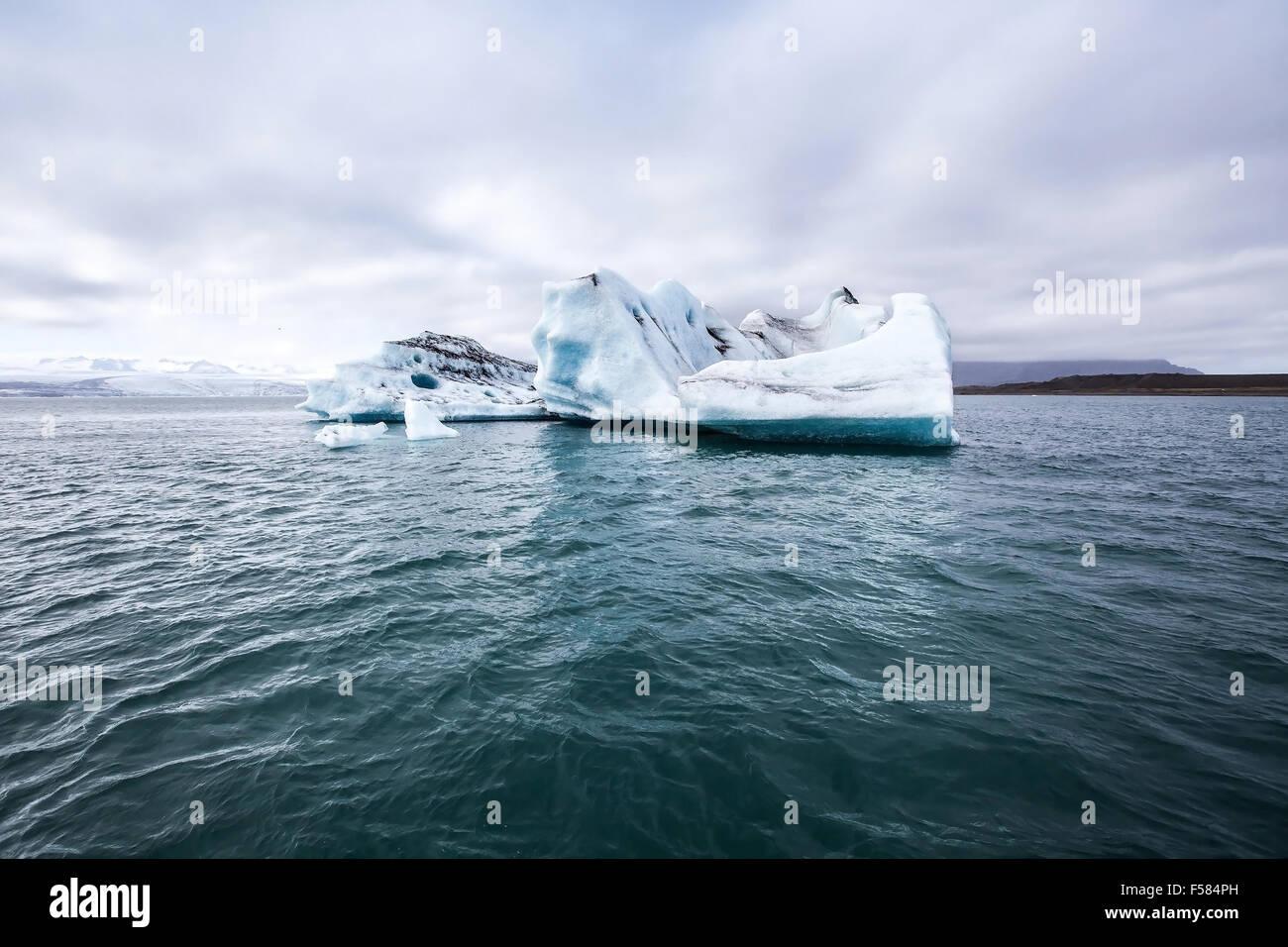 melting iceberg, global warming background - Stock Image