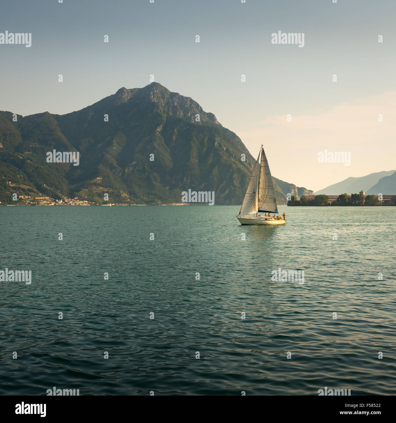 In the picture a view of Lake Iseo from the city of Lovere, on the side of a sailboat. - Stock Image