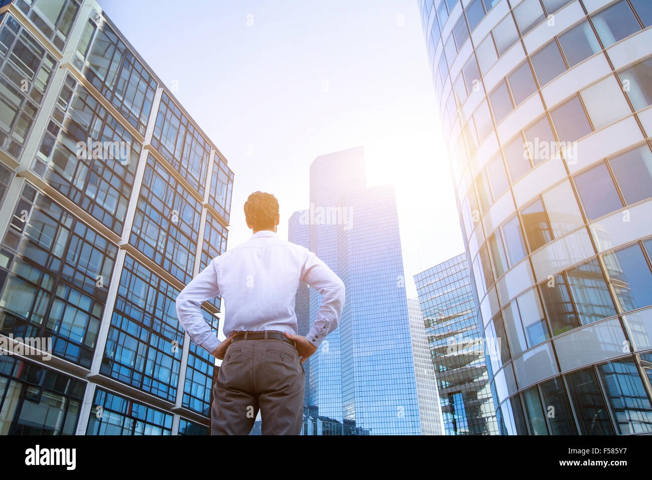 career concept, business background, man looking at office buildings - Stock Image