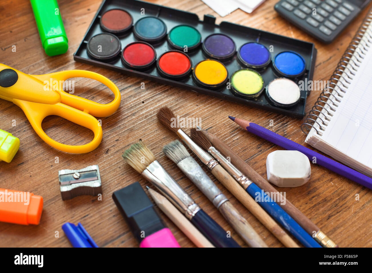 school supplies on wooden table - Stock Image