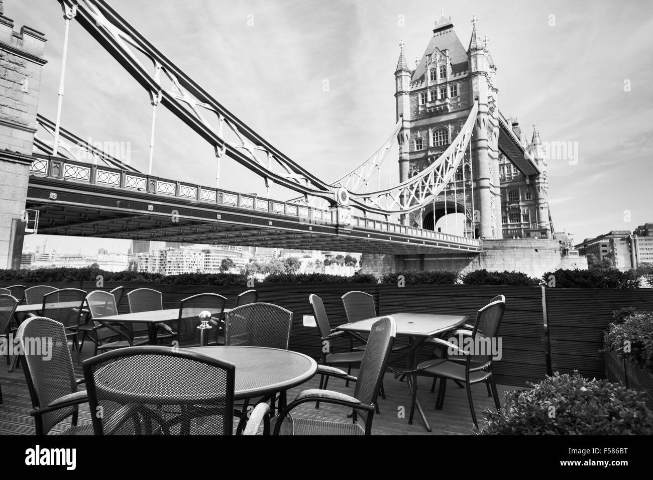 Beautiful black and white view of london with cafe on terrace near tower bridge