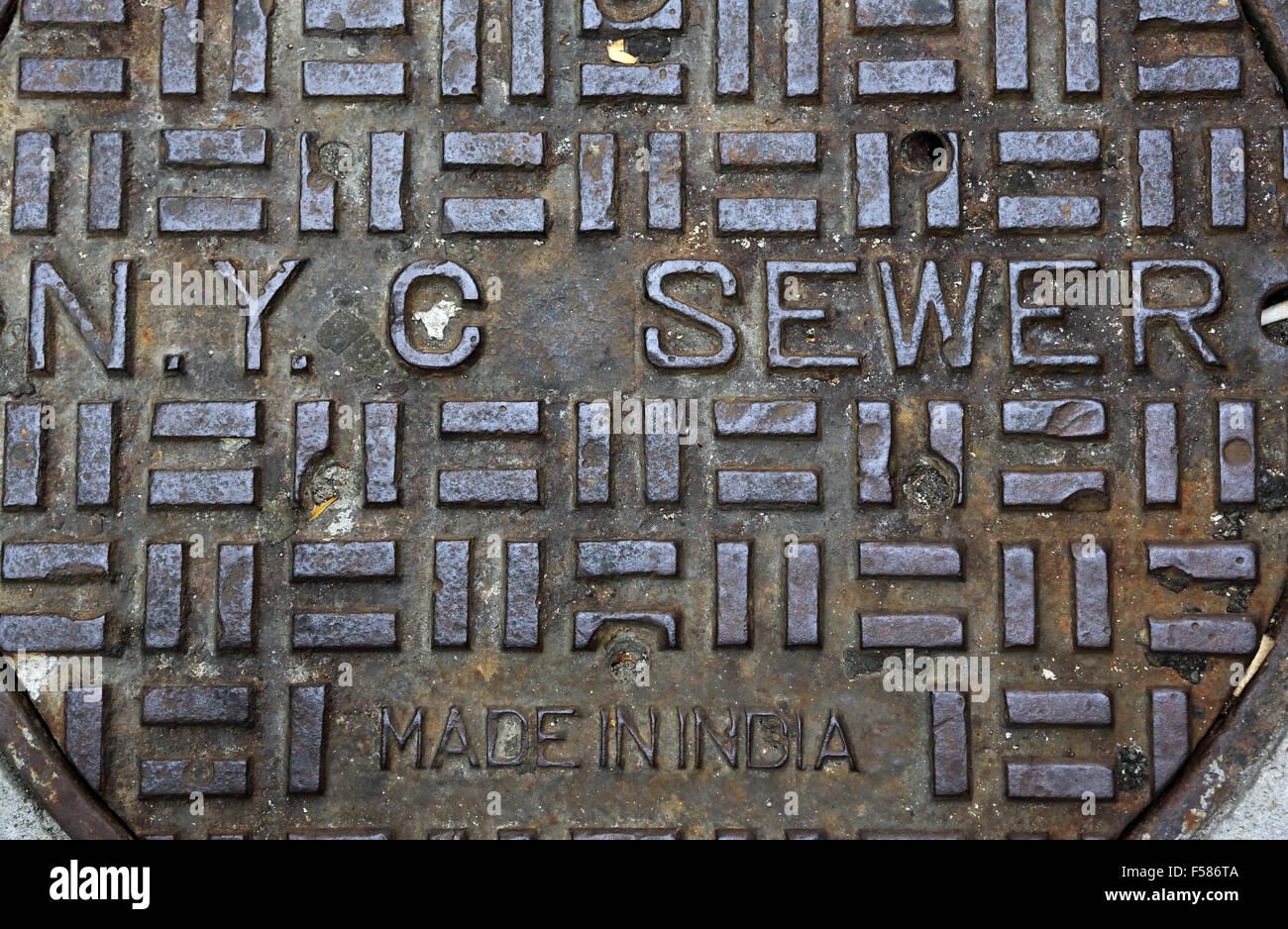 NYC New York City manhole cover made in India. Manhattan, New York City, USA - Stock Image