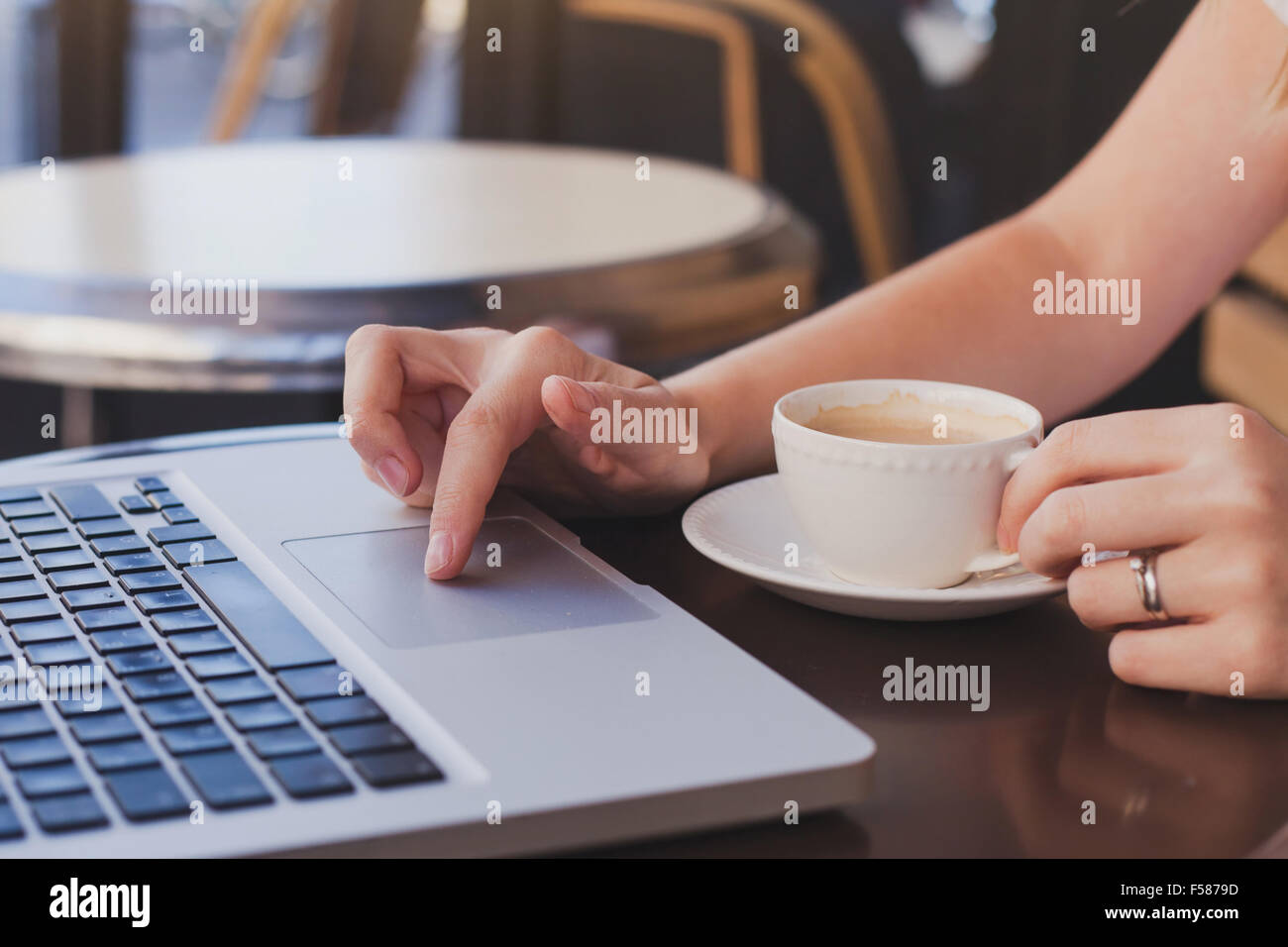 checking email in cafe with cup of coffee - Stock Image