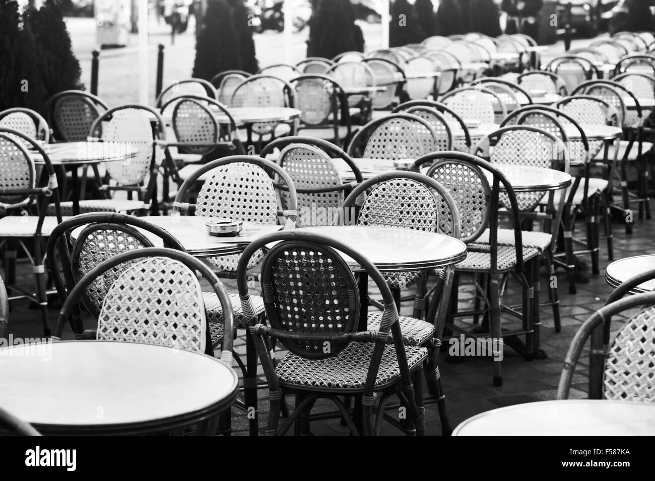 Vintage street cafe in paris black and white photo of wicker chairs and tables