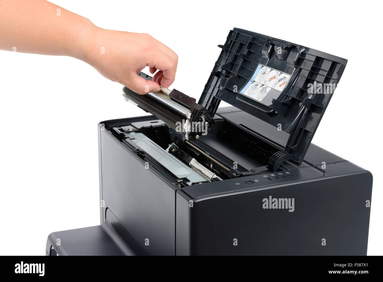 replace black toner cartridge in a laser printer, isolated on white - Stock Image