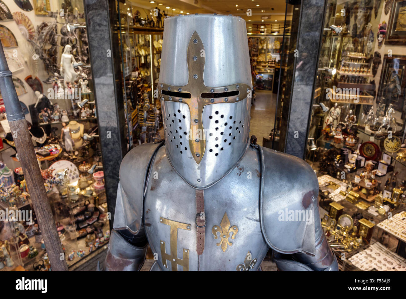 Toledo Spain Europe Spanish store business shopping forged metals souvenirs gift shop suit of armor armour Medieval - Stock Image