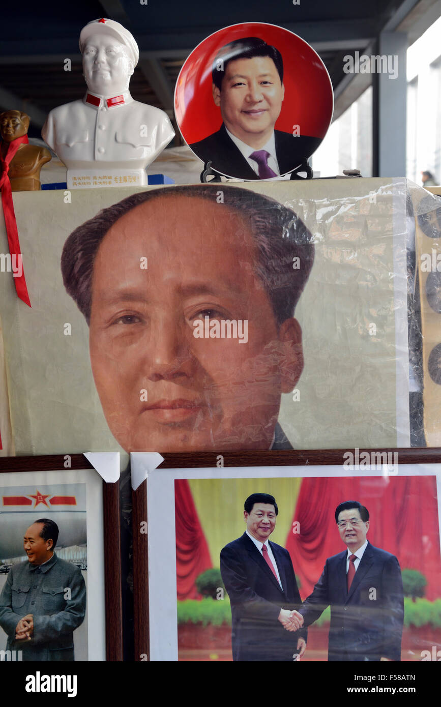 Memorabilia of Chinese president Xi Jinping is on sale with that of Mao Zedong and Hu Jingtao in a flea market in - Stock Image