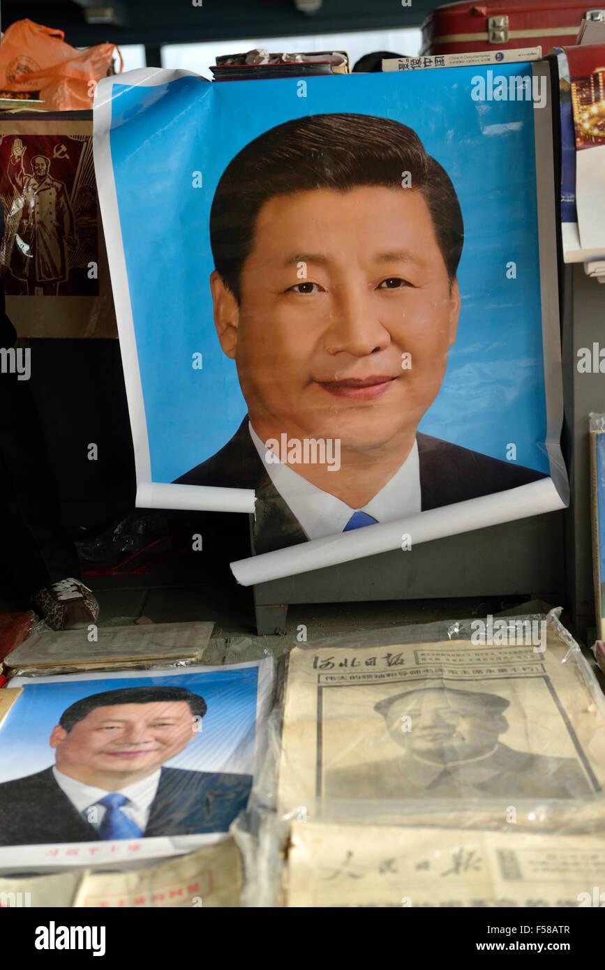 Memorabilia of Chinese president Xi Jinping is on sale in Panjiayuan flea market in Beijing, China. 2014 Stock Photo