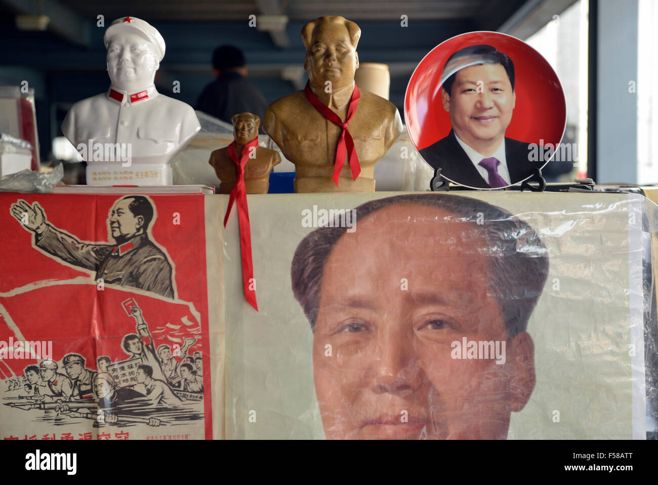 Memorabilia of Chinese president Xi Jinping is on sale with that of Mao Zedong in Panjiayuan flea market in Beijing, Stock Photo