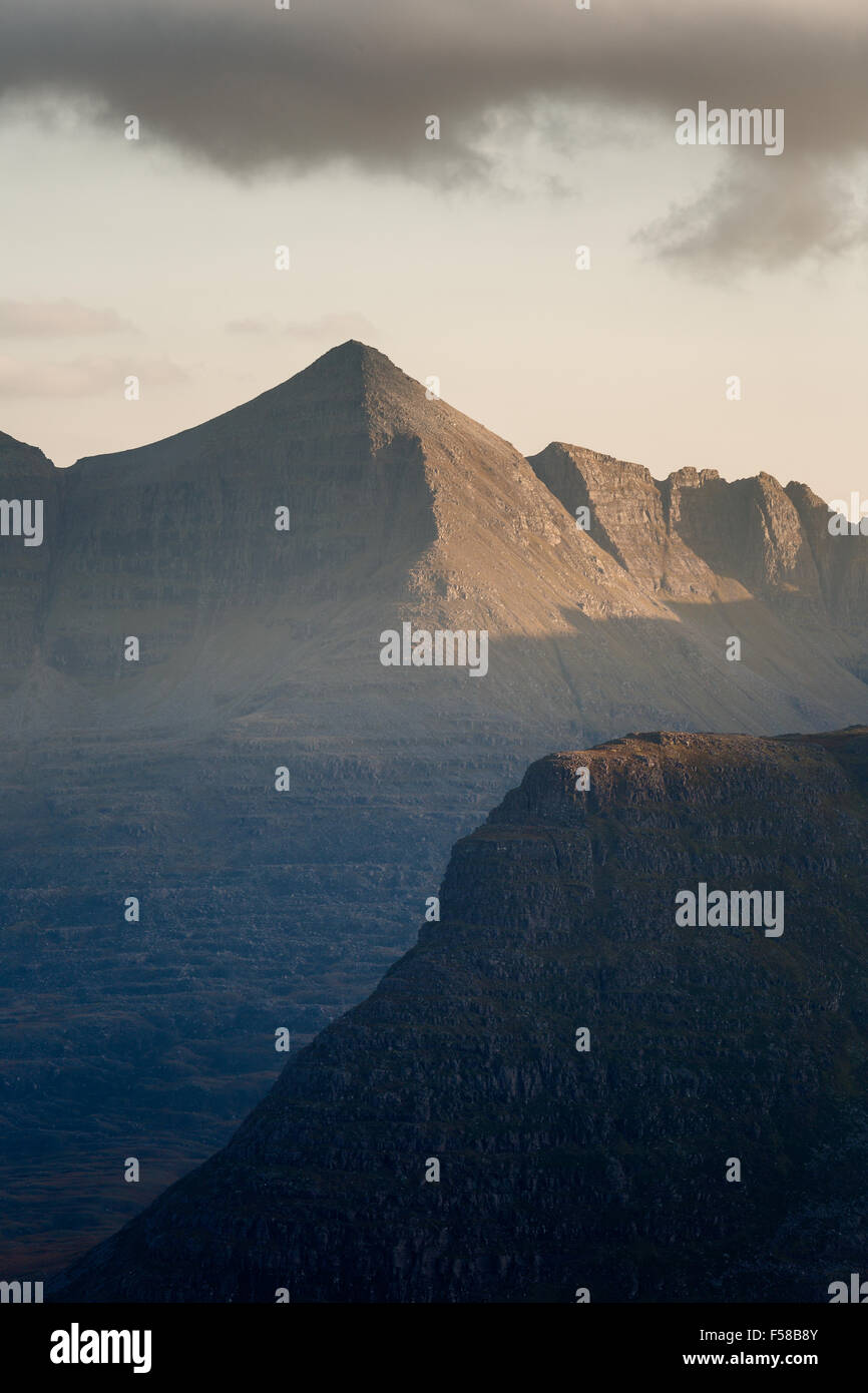 Spidean a' Choire Leith (Liathach) behind Carn na Feola sidelit by soft afternoon light, Scotland, UK - Stock Image