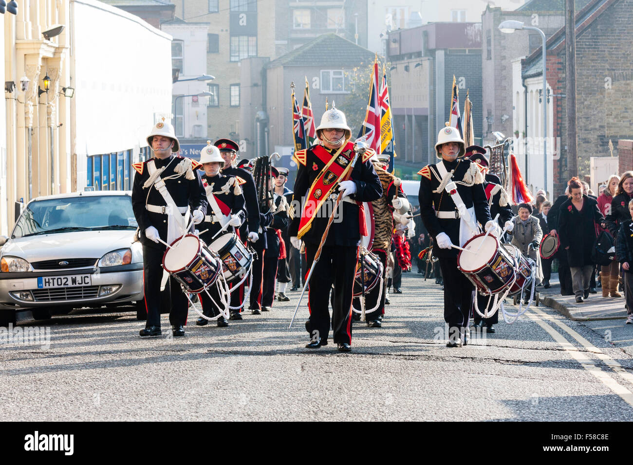 England, Ramsgate. November Remembrance Sunday Ceremony. Air-force youth band marching in parade in street towards - Stock Image