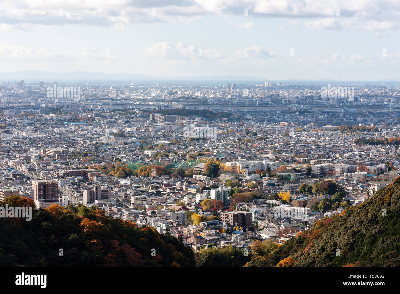 Japan, Osaka. Famous scenic view from mountains at Mino of the city sprawling to the coast. Blue sky with clouds. - Stock Image