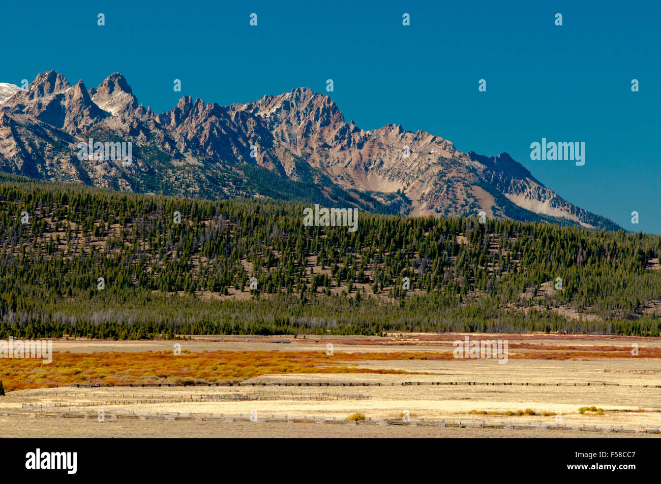 Sawtooth Mountains, lateral moraine, and Salmon River riparian corridor in Sawtooth Valley, Idaho - Stock Image