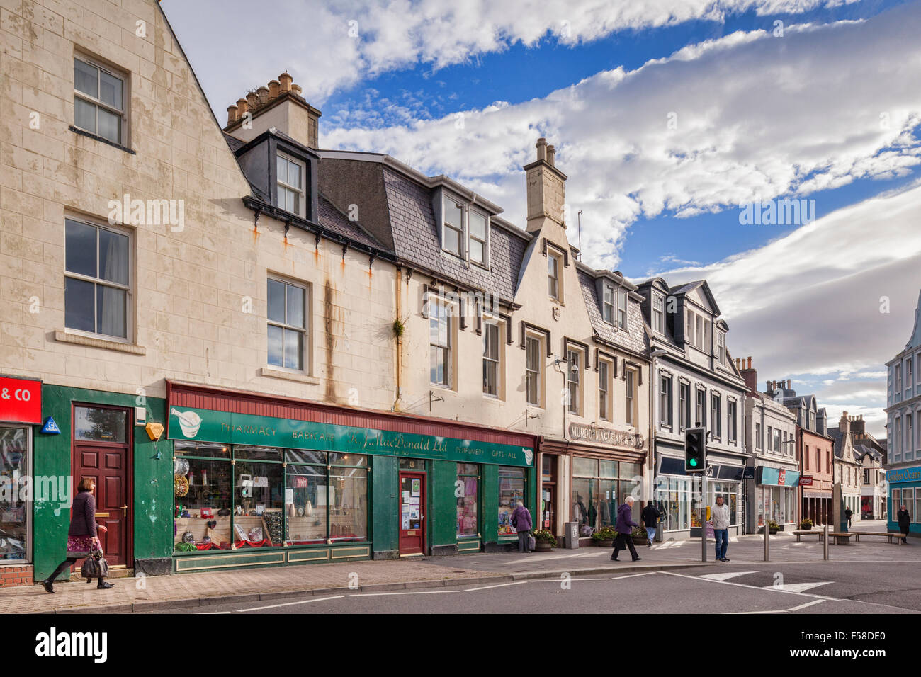 Shops and shoppers along Cromwell Street in Stornoway, Isle of Lewis, Outer Hebrides, Scotland, UK. - Stock Image