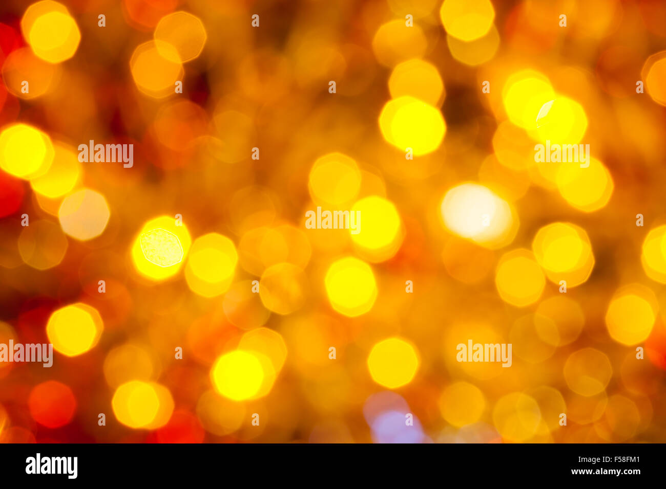 abstract blurred background - brown, yellow and red flickering Christmas lights bokeh of electric garlands on Xmas Stock Photo