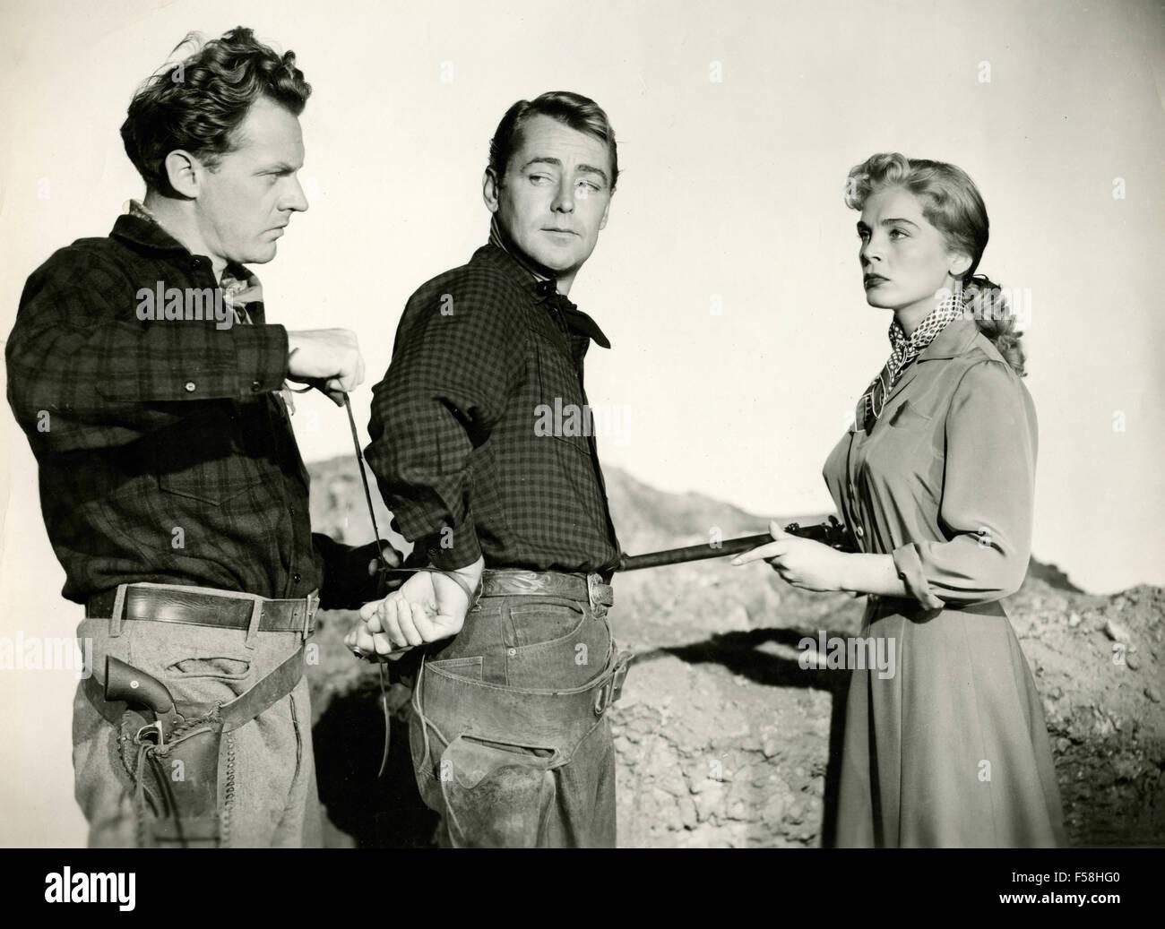 Alan Ladd, Lizabeth Scott and Arthur Kennedy in Red Mountain - Stock Image