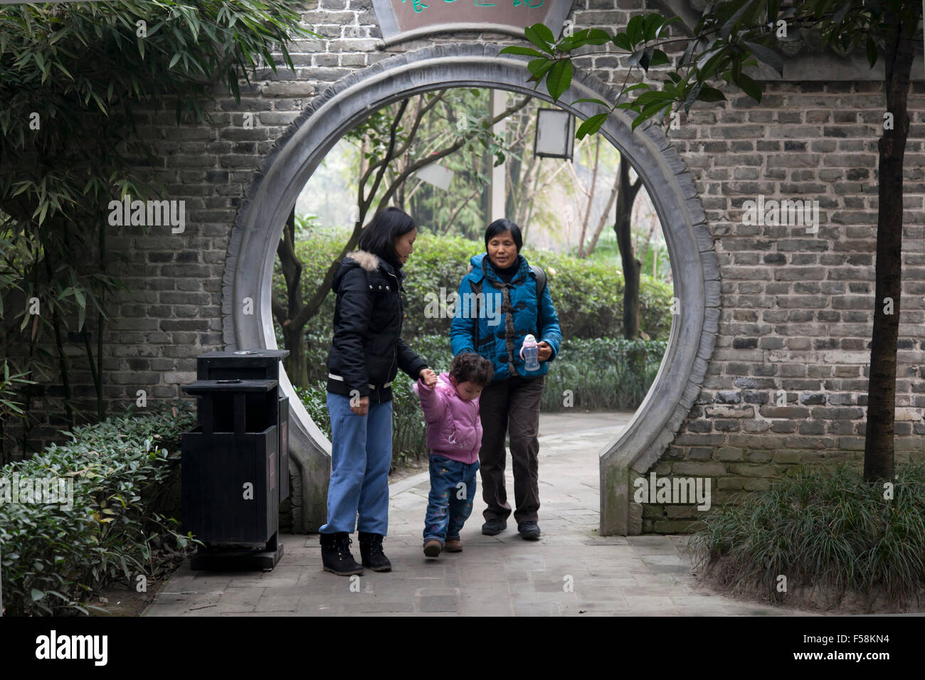 Three generations of Chinese women strolling in an old garden at an old town called Pixian at the outskirts of Chengdu - Stock Image