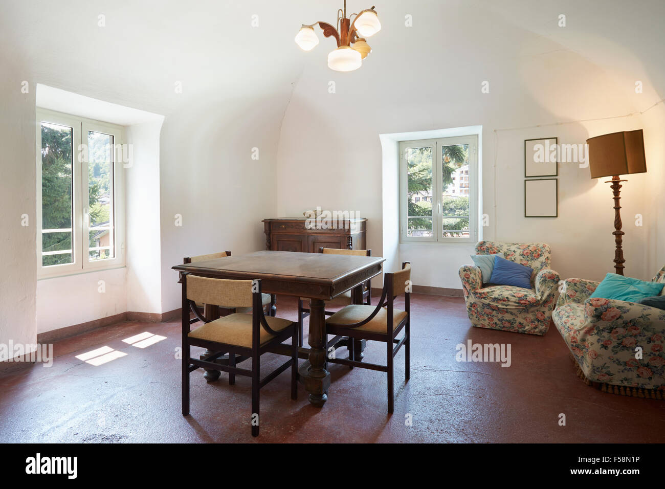 Living room, old interior with table and four chairs Stock Photo ...