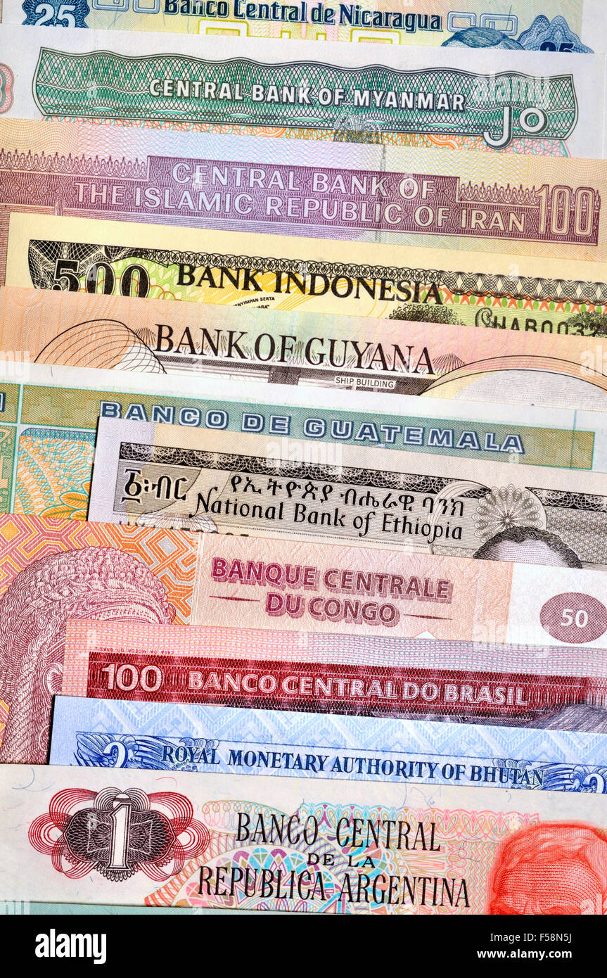 Banknotes from around the world showing the names of their National Banks - Stock Image