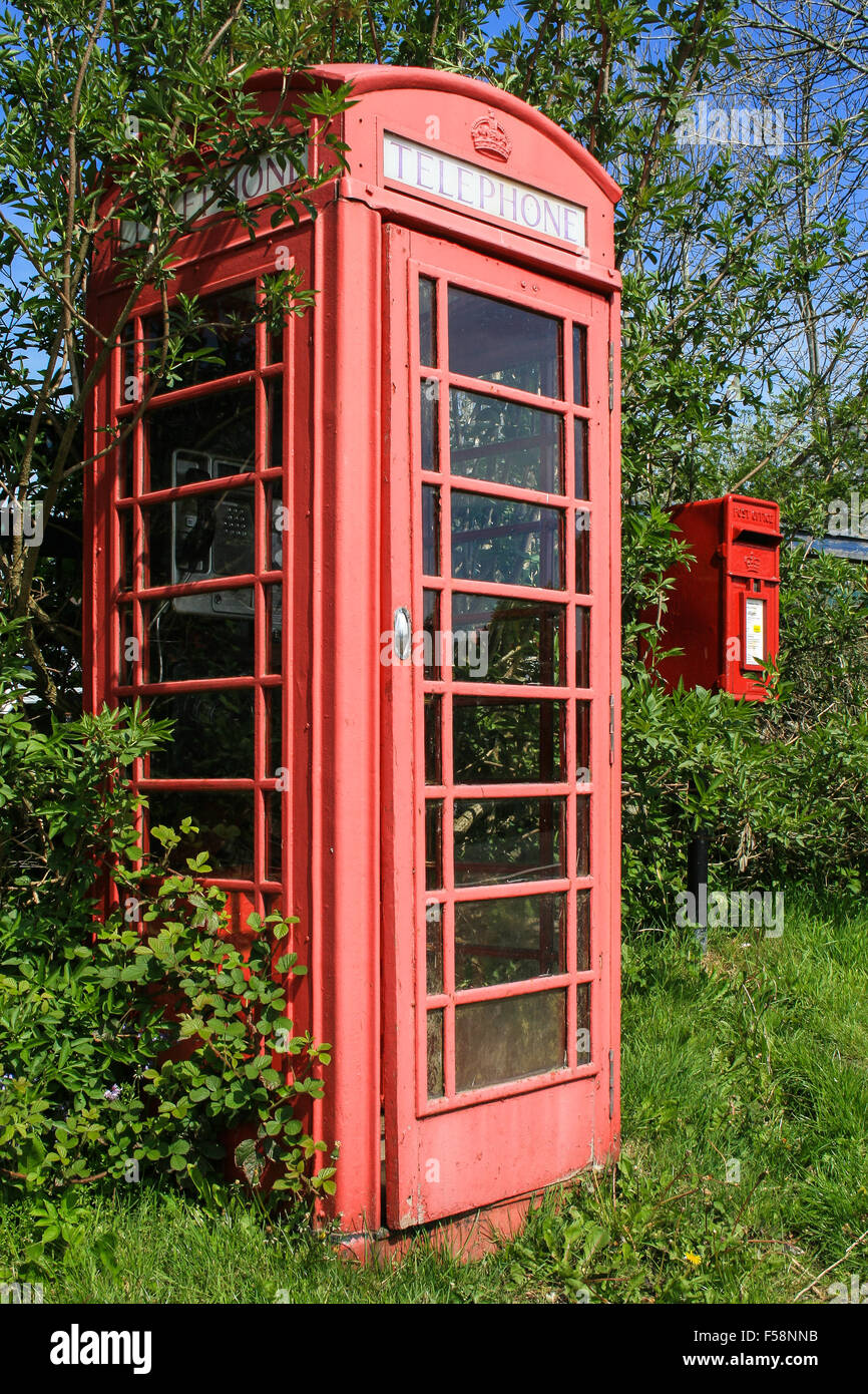 The Age of Communication - an old fashioned telephone box and a post box side by side - Stock Image