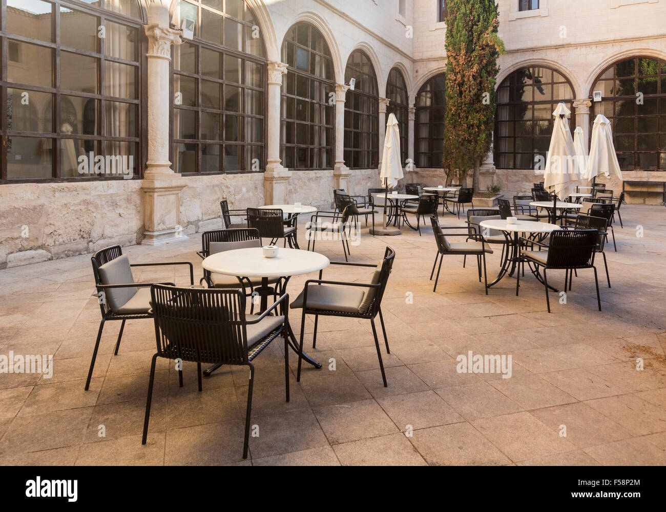Courtyard with tables and chairs in Spain, Europe - Stock Image