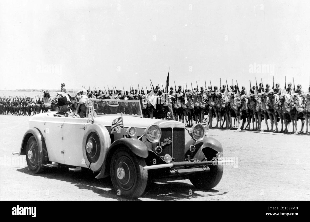 KING ABDULLAH I OF TRANSJORDAN in his Daimler car reviewing the Camel Corps ion 25 May 1946 on the occasion of his - Stock Image