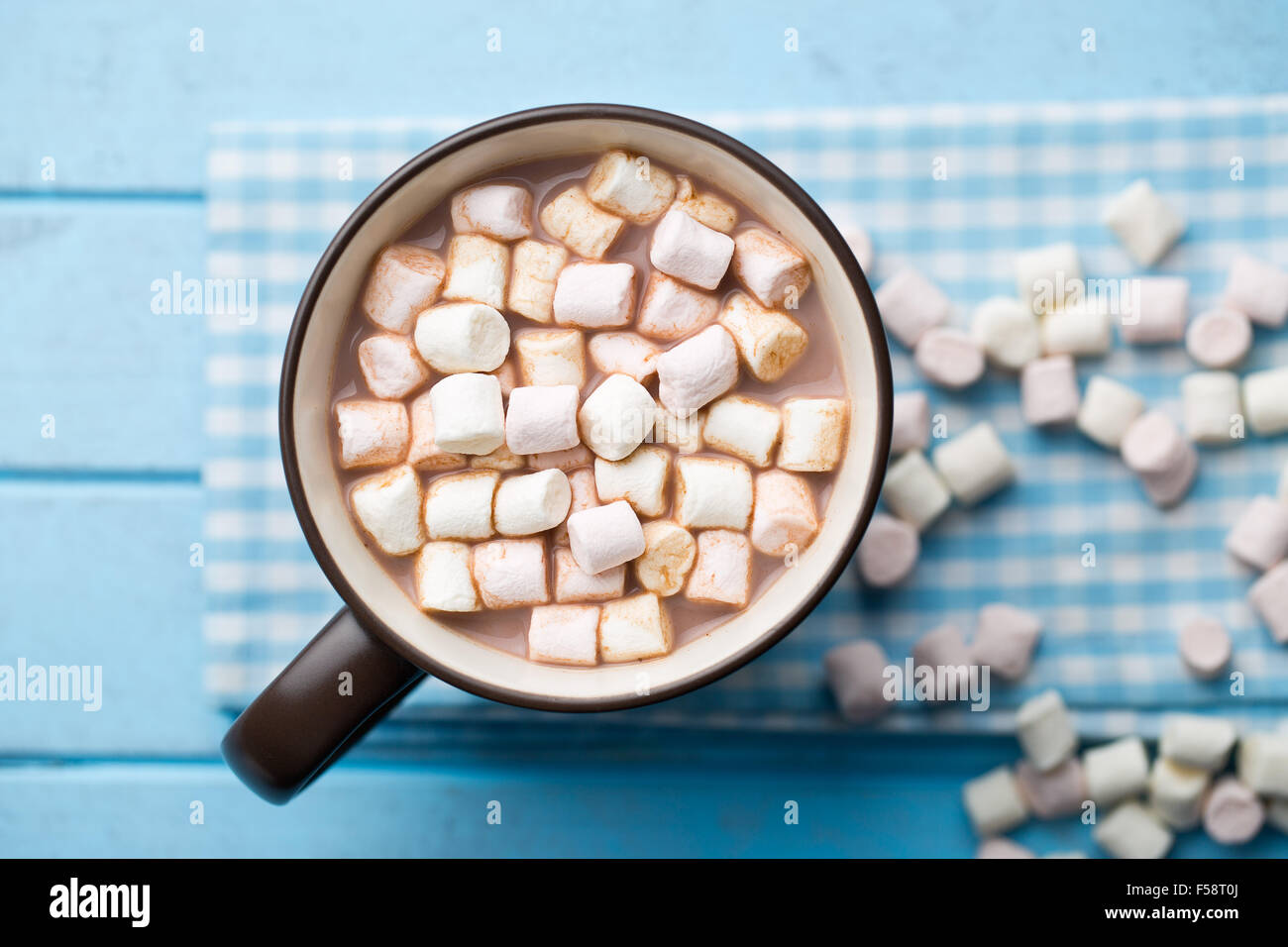 Cocoa drink with marshmallows in mug on table - Stock Image