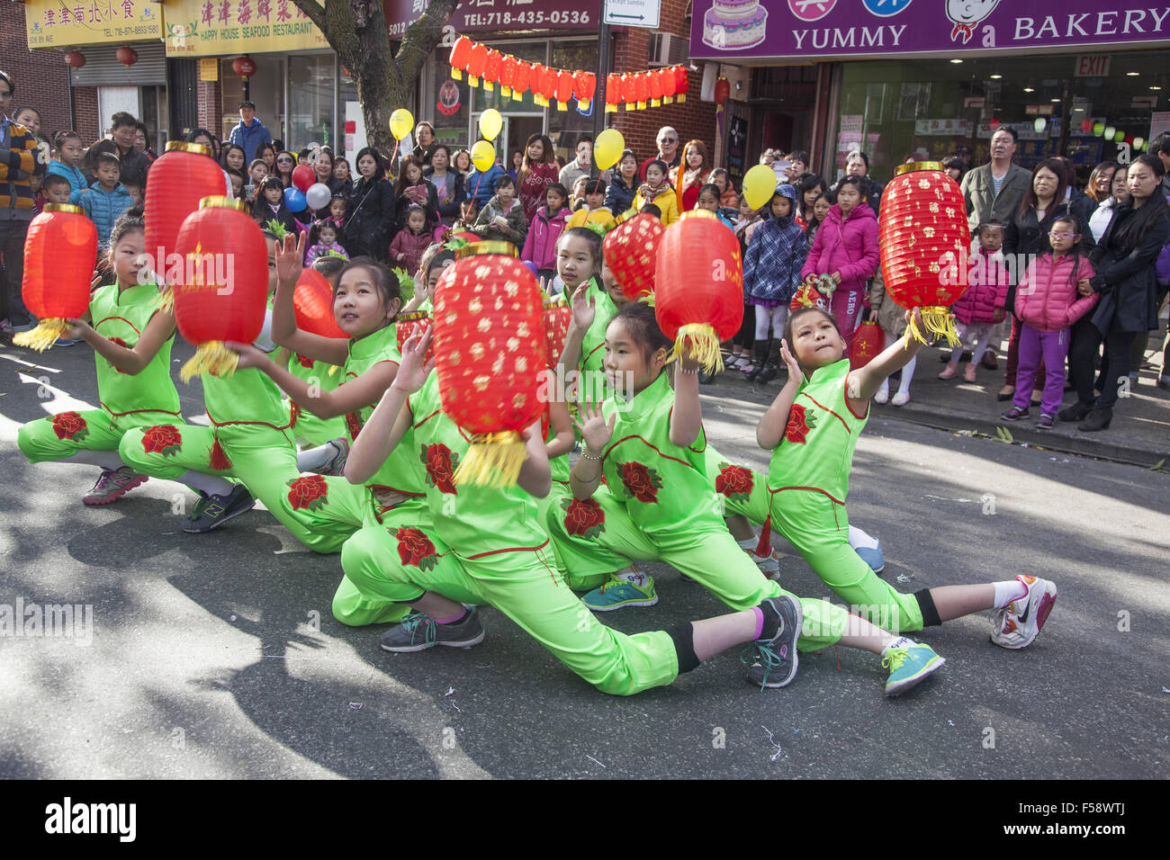 Children's dance troupe perform at the Chinese Autumn Festival and Lantern Parade in the Chinatown neighborhood - Stock Image