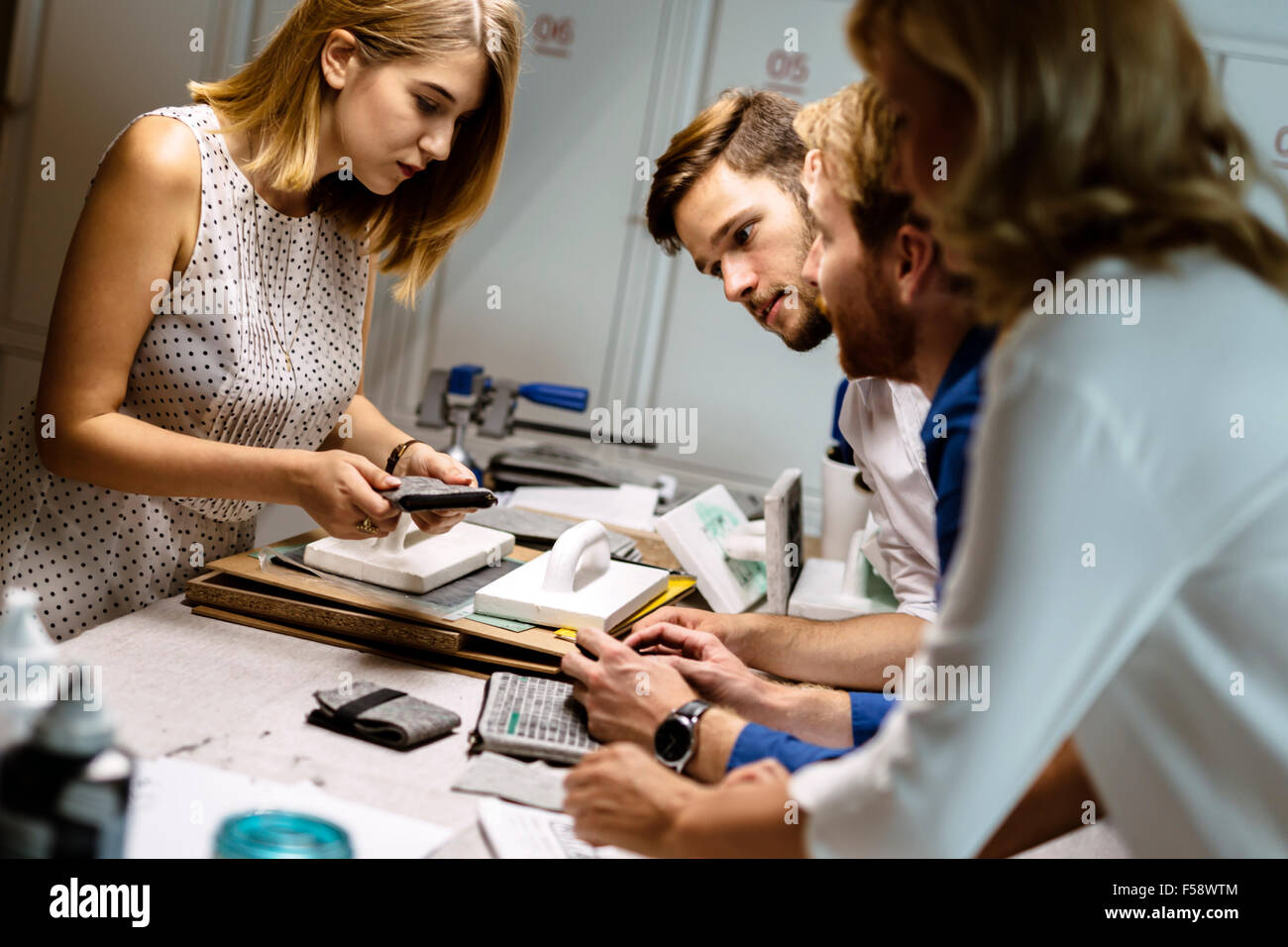creative coworkers putting their imagination to the test in designing clothes - Stock Image