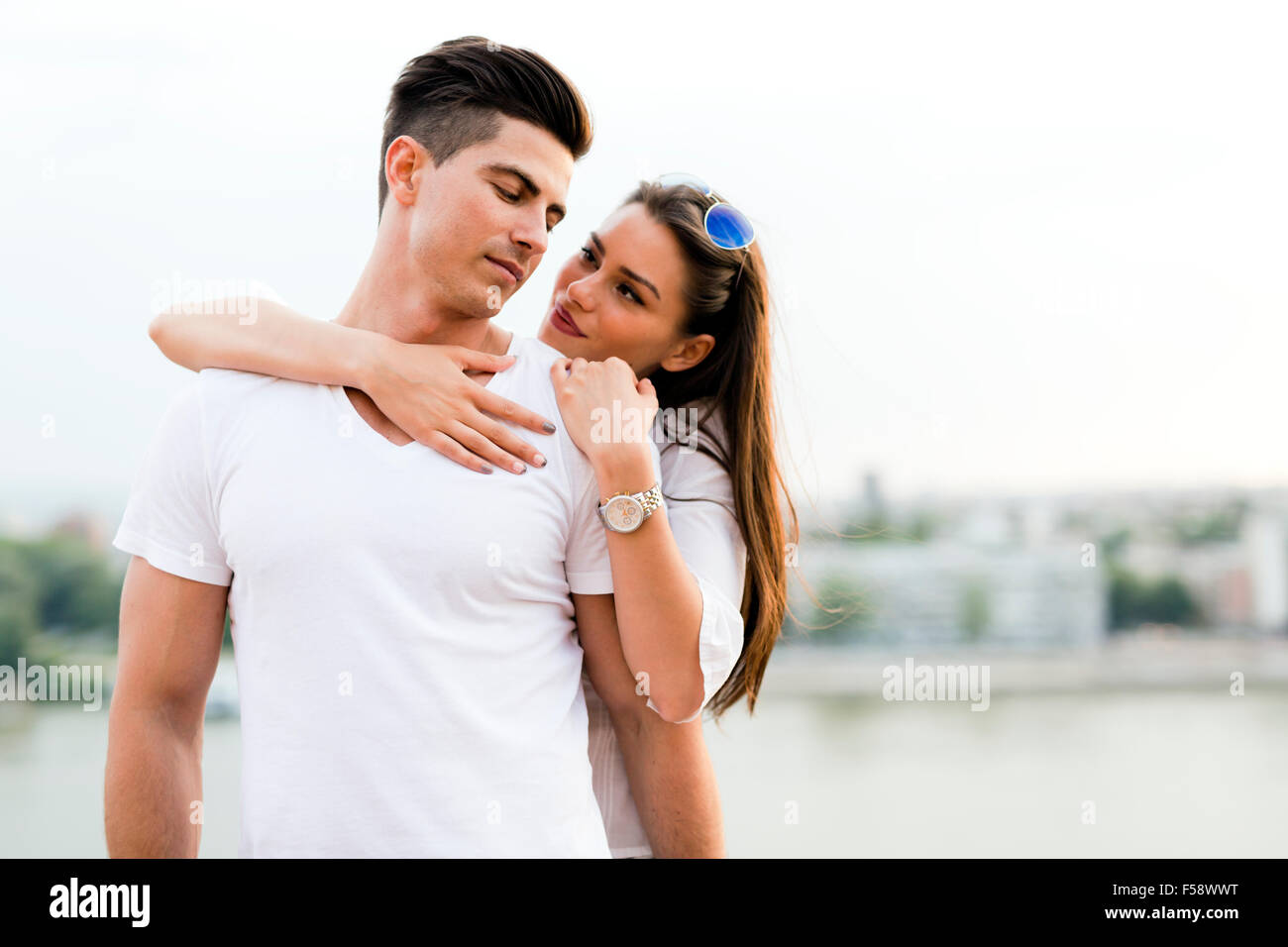 Young and beautiful couple in love bonding with each other - Stock Image
