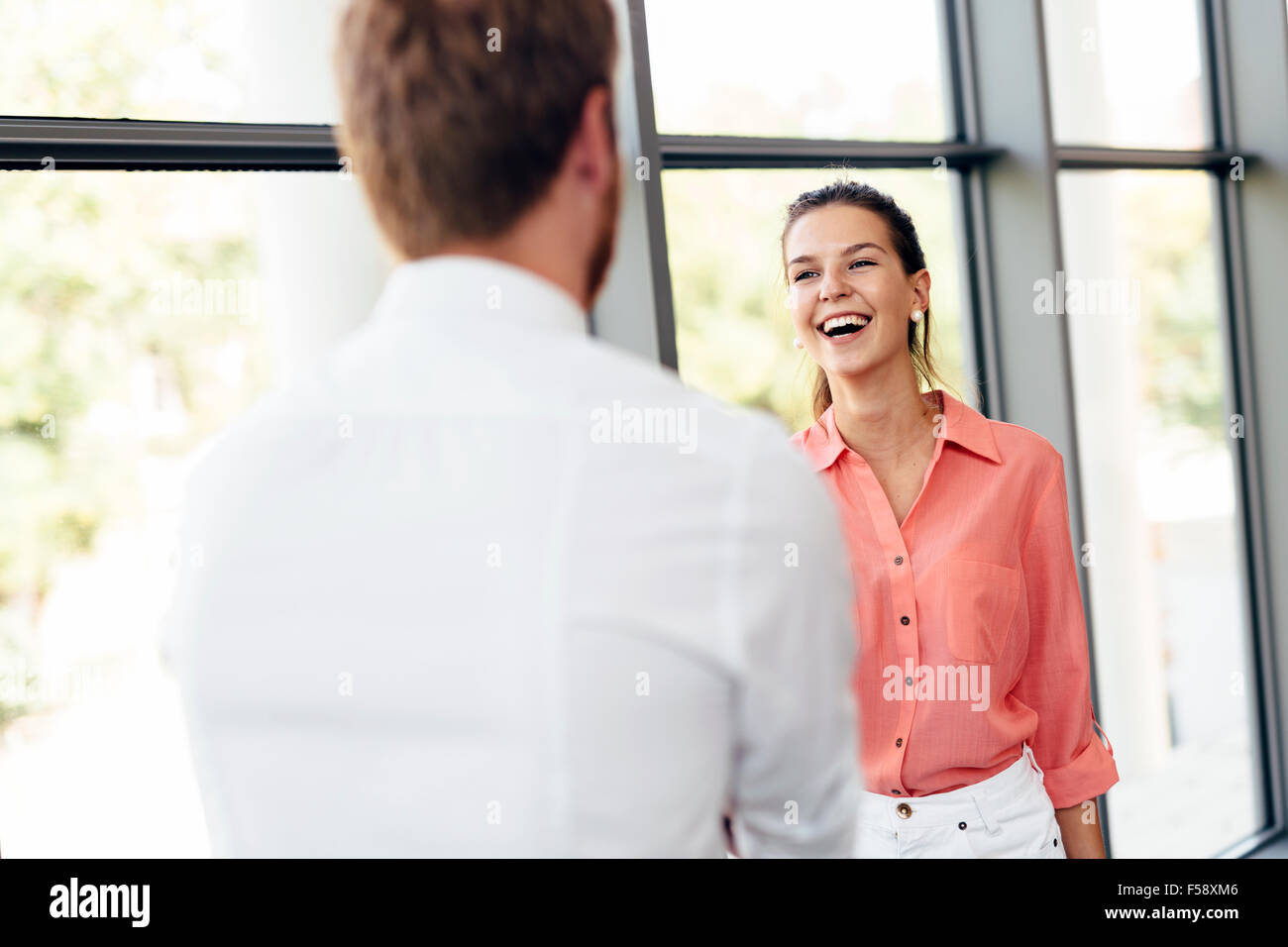 Happy business people shaking hands and being happy for meeting - Stock Image