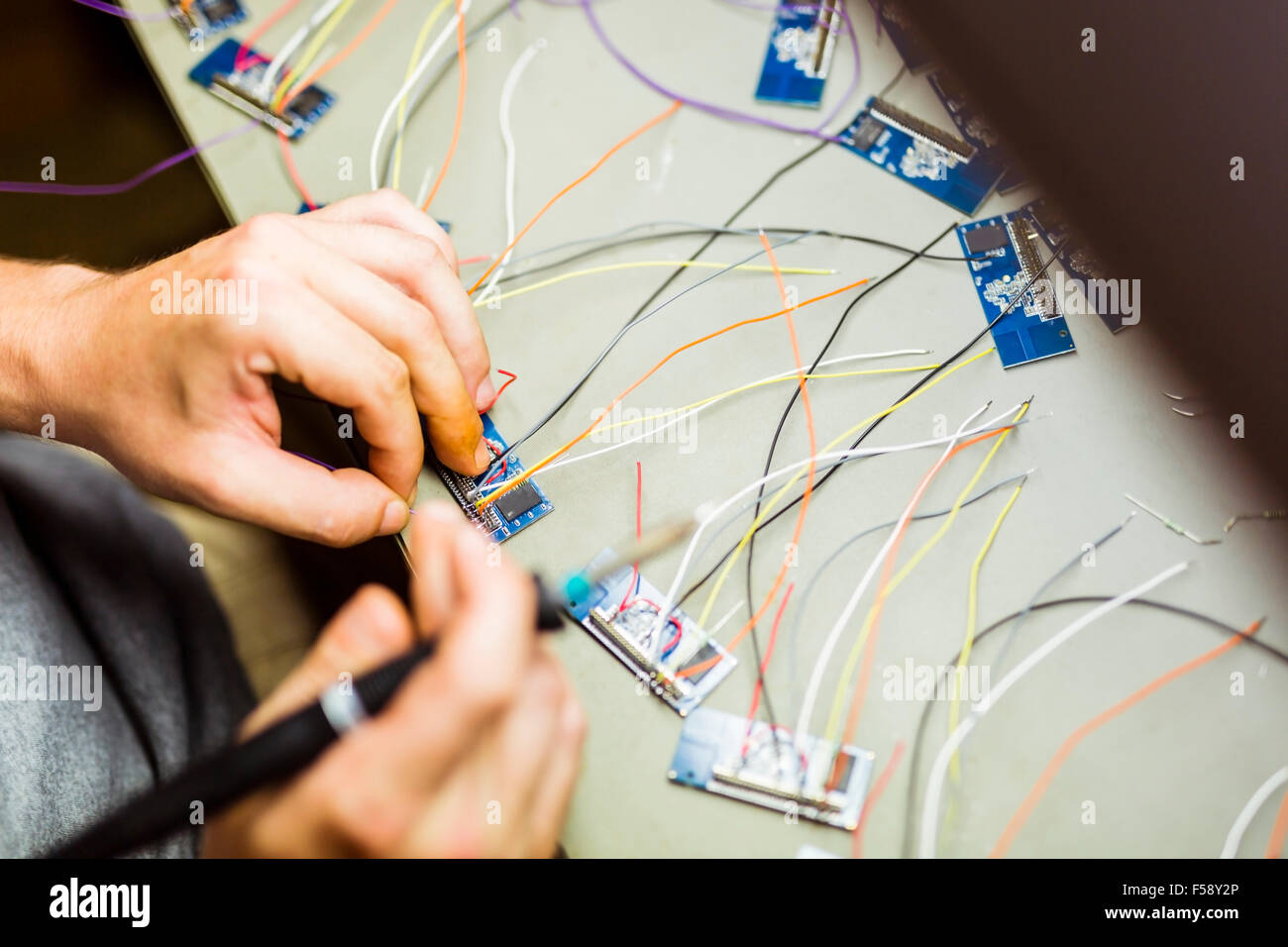 Hardware chips being fixed by soldering - Stock Image