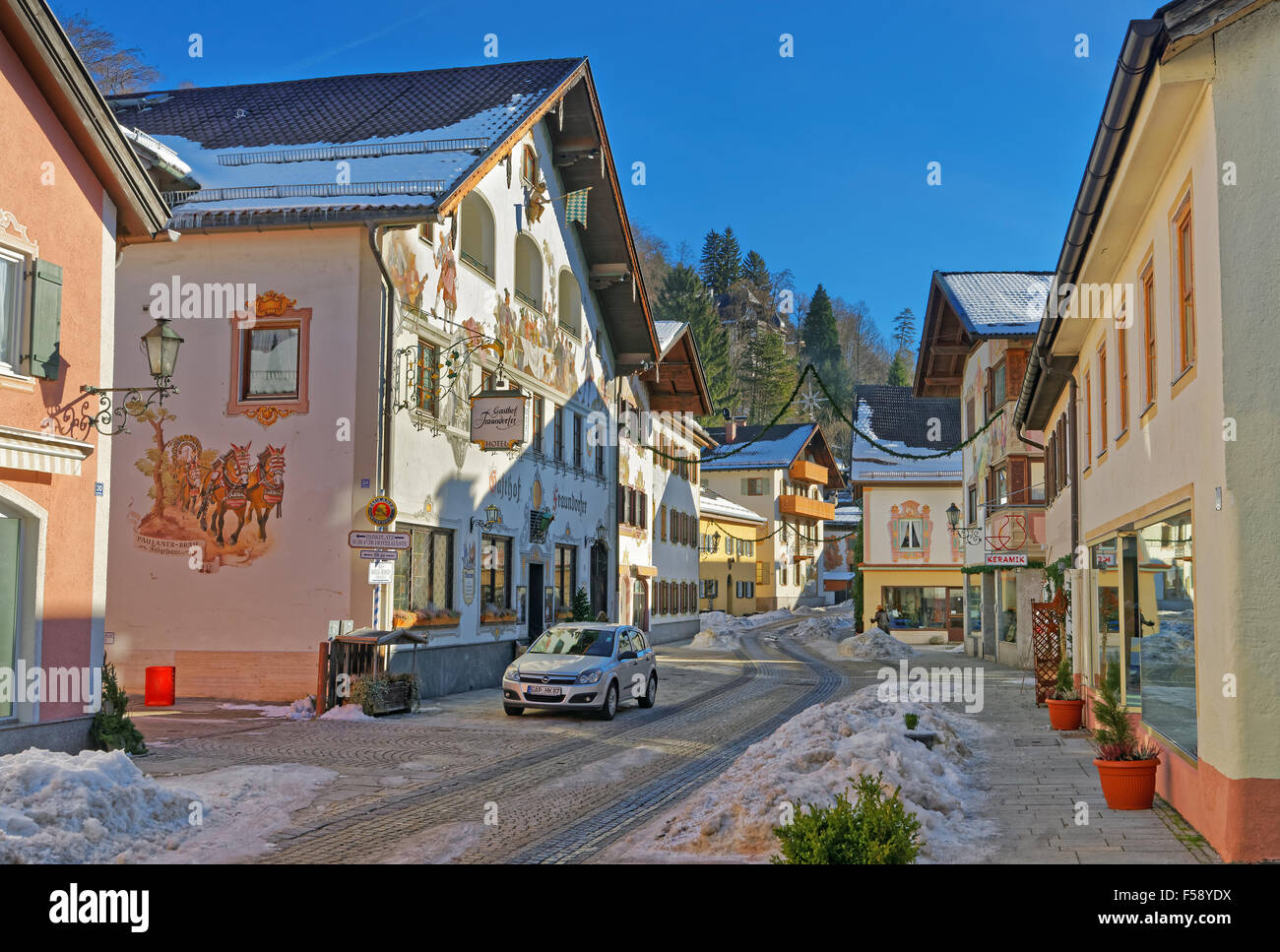Enchanting Upper Bavarian-styled homes in Garmisch-Partenkirchen, adorned with painted scenes. Almost every buildings - Stock Image