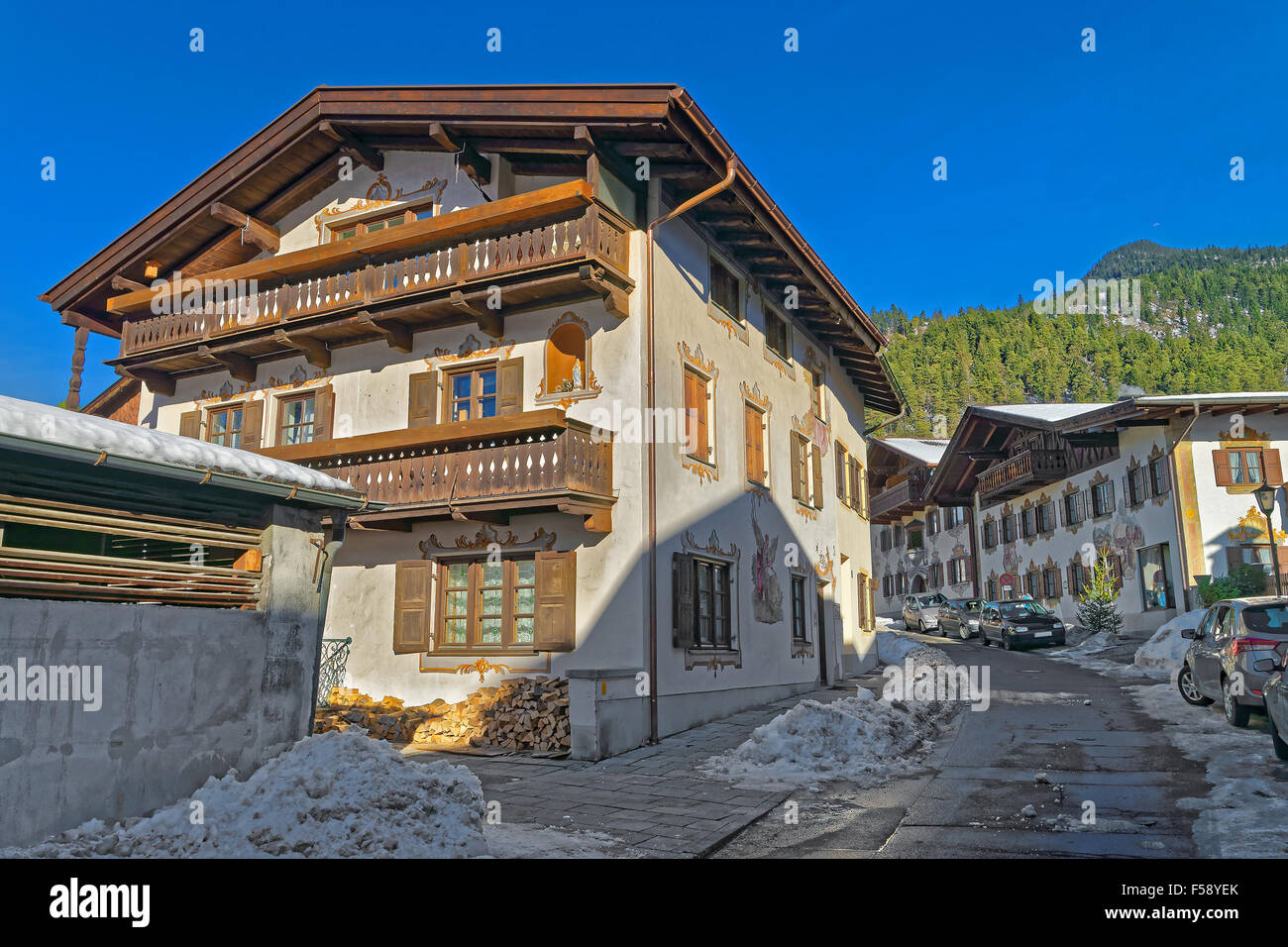Cozy street in Bavarian Village Garmisch-Partenkirchen (Germany), on a sunny winter day. It is a tourist and winter - Stock Image
