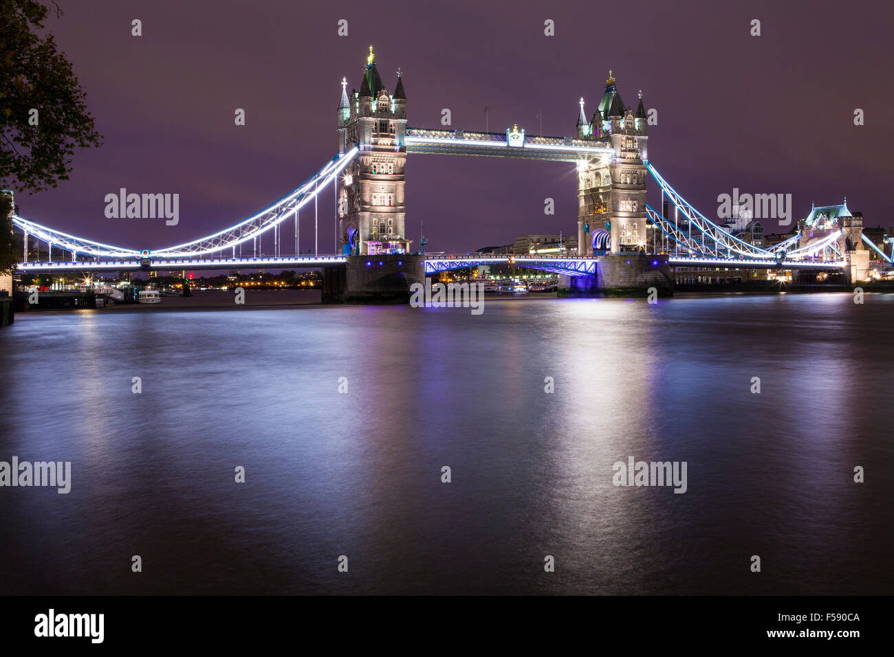 A magnificent night-time view of Tower Bridge and the River Thames in London. - Stock Image
