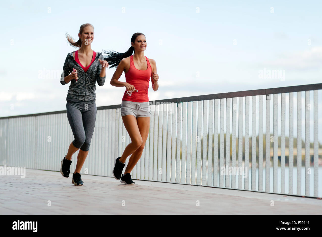 Fit women jogging outdoors and living a healthy lifestyle Stock Photo