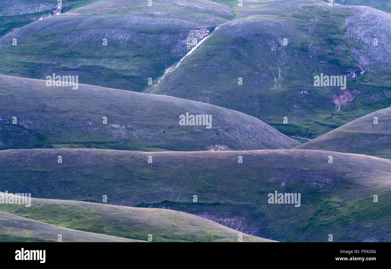 After sunset, dusk at Monti Sibillini National Park, Castelluccio di Norcia, Umbria, Italy - Stock Image