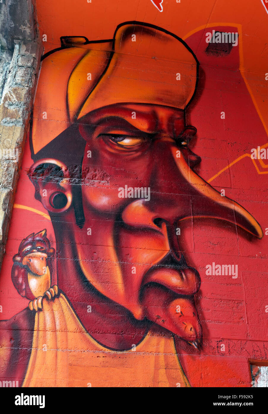 Grimace, evil eye, long nose, graffiti, street art, Duisburg, North Rhine-Westphalia, Germany - Stock Image