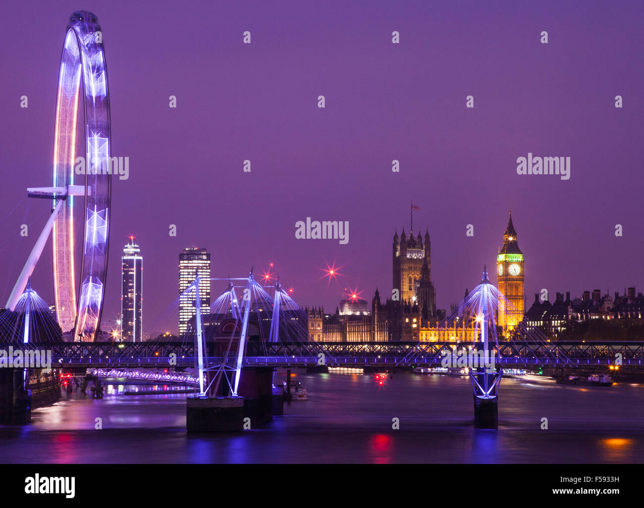 An evening view of London taking in the sights of the Houses of Parliament, the London Eye and the River Thames. - Stock Image