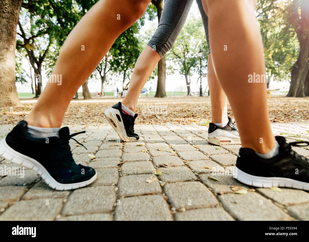Closeup of joggers feet while in action and running - Stock Image
