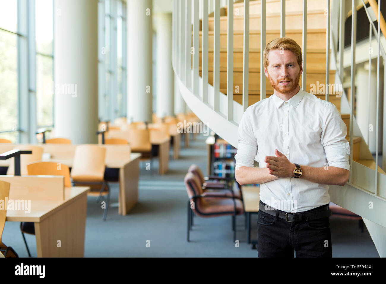Smart student promoting library as a source of knowledge to the new generation - Stock Image
