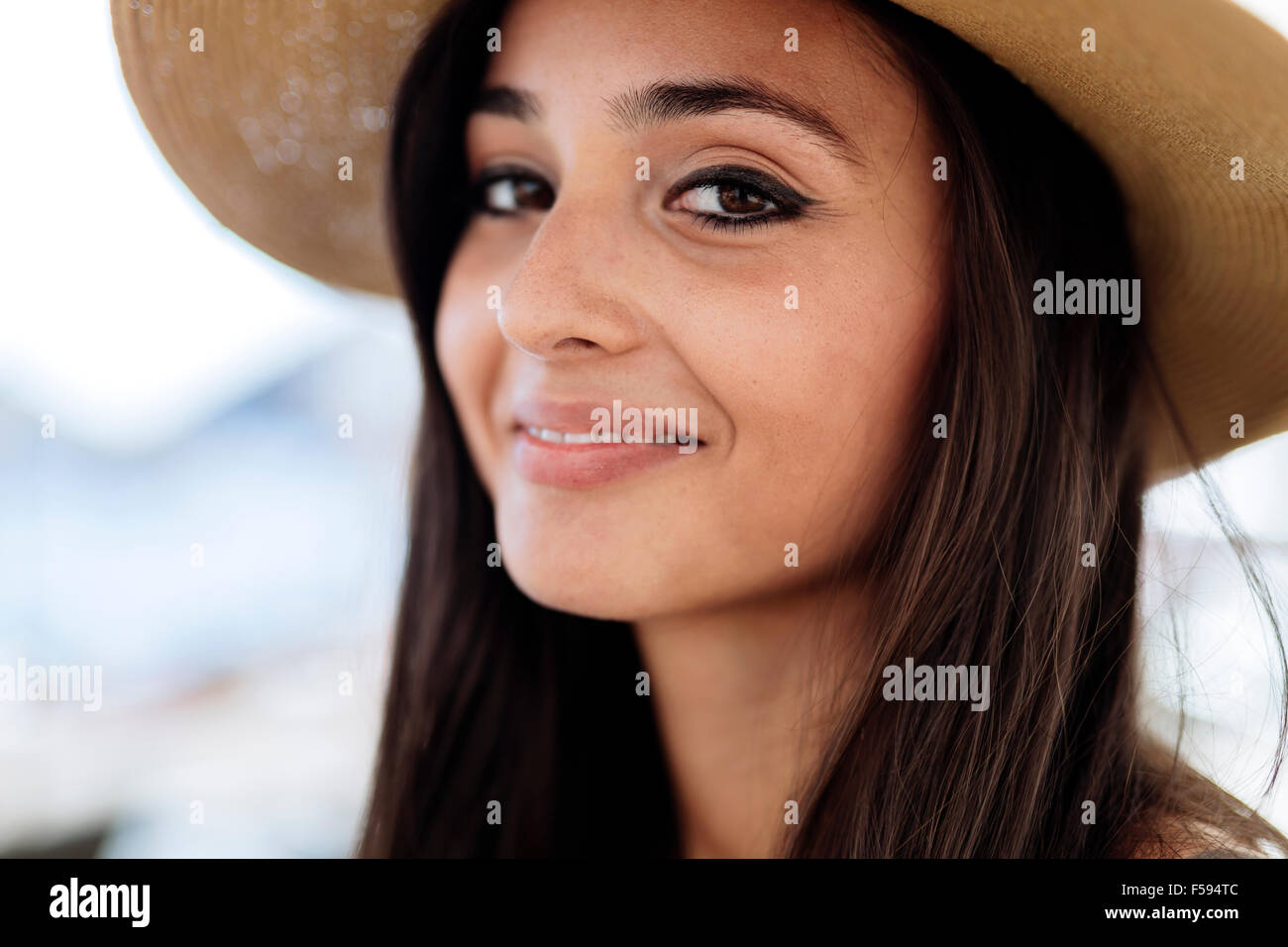 Attractive young woman in hat smiling - Stock Image